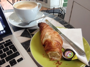 People watching with a latte croissant and marmite