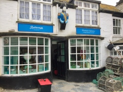 Filming finished before we arrived in Port Isaac. Later that day the props guys dismantled Mrs T's chemist and reinstated the Cornish fudge shop. We did buy fudge!