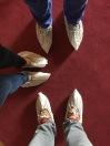 Wearing shoe protectors.
