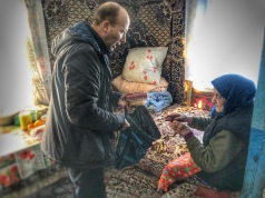 Visiting elderly with food parcels.